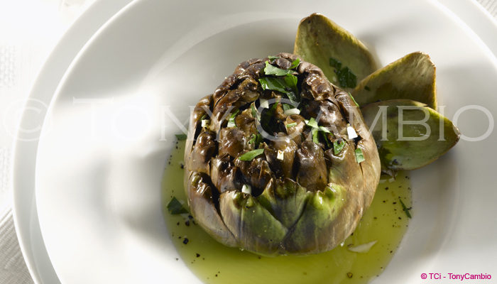 An Artichoke on a White bowl